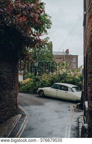 London, Uk - July 02, 2020: Retro Car Parked On A Hampstead Street In The Rain, Selective Focus. Ham