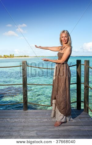 The beautiful woman suggests to swim in the sea