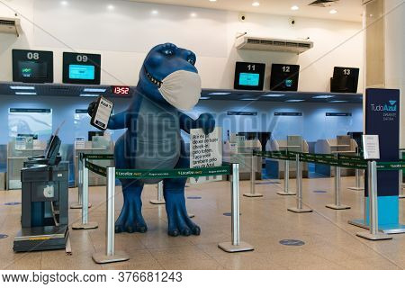 Rio De Janeiro, Brazil - July 16, 2020: Blue Dinosaur With Protective Face Mask At The Check In Coun