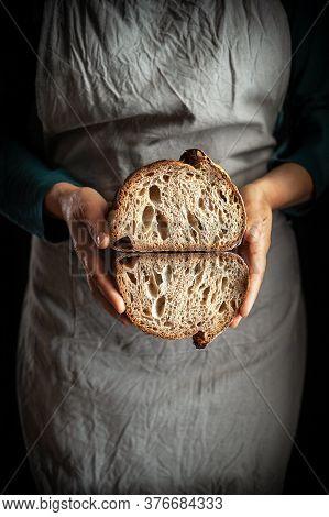 Whole Wheat Sourdough Bread In The Baker Hands