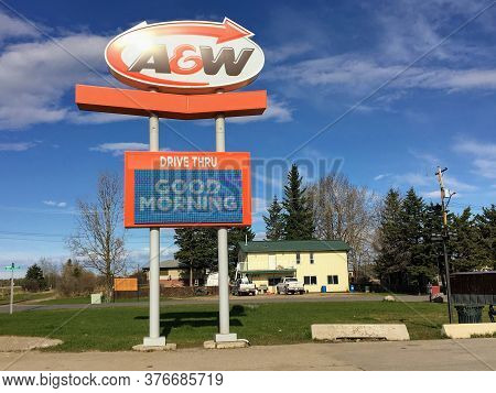 Yellowhead Highway, Alberta, Canada - May 16th, 2020: A Huge A&w Drive Through Sign Wishing Customer