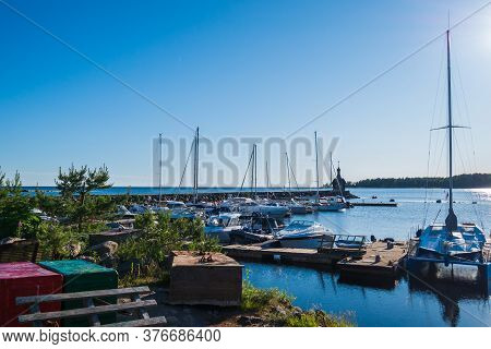 Yacht Club, With A Lot Of Different Yachts And Boats, Ships. Beautiful Nature, Green Forest In The B