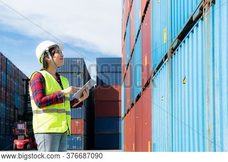 Engineer Woman Or Foreman Manager In Container Depot Working With Digital Tablet For Control And Che