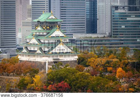 Osaka Castle With Japanese Garden And City Office Building Skyscraper At Autumn Season In Osaka, Jap