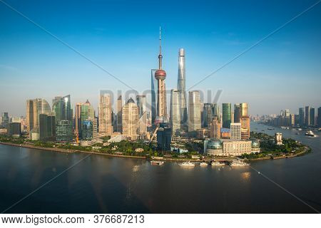 Aerial View Of Pudong Skyline With Oriental Pearl Tower And Lujiazui Business District Skyscraper Wi