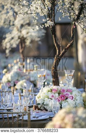 Wedding Party Table Decor For A Ceremony During The Springtime With Pink And White Roses As Decor