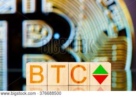 Btc Concept. Wooden Blocks With Btc Inscription And Arrows Symbolizing The Rise And Fall
