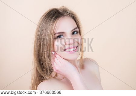 Cute Woman. Smiling Young Woman Looking Up Over Studio Isolated Background. Beautiful Smiling Woman