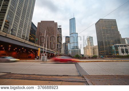 Chicago Usa-  August 27 2015; 1cars Blurred Passing In  Street Scene, Intersection East Upper Whacke