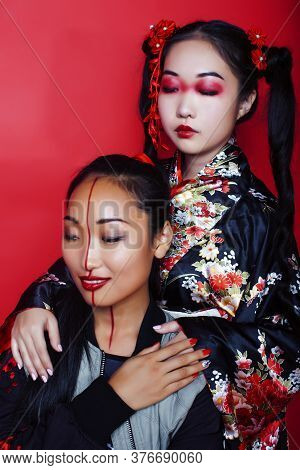Two Pretty Geisha Girls Friends: Modern Asian Woman And Traditional Wearing Kimono Posing Cheerful O