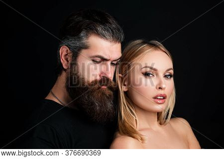 Portrait Of Stylish Fashion Couple On Black Background. Fashionable Attractive Couple Posing On Blac