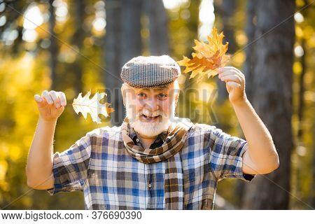Freedom Retirement Concept. Senior Citizen Stroll In A Park In Autumn. Portrait Of Happy Senior Man