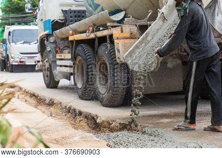 Mixed Concrete Pouring At Construction Site. Pouring Cement During Sidewalk Upgrade. Pour Concrete,p