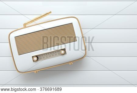 Vintage Style Radio Receiver On White Floor, Flat Lay. Whitel Color And Golden Details. Retro Radio