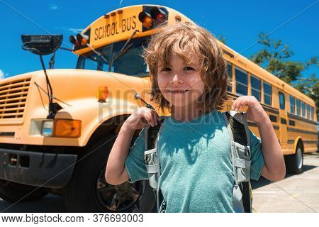 Child School Concept. Portrait Of Happy School Child. Child From Elementary School With Bag On Schoo