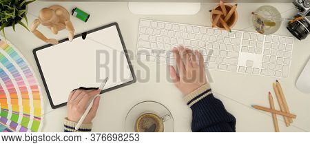Female Designer Working With Mock Up Tablet, Computer And Designer Supplies On White Desk
