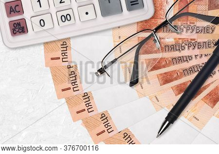 5 Belorussian Rubles Bills Fan And Calculator With Glasses And Pen. Business Loan Or Tax Payment Sea