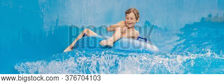 Boy On A Pool Float On Artificial Waves In A Water Park Banner, Long Format