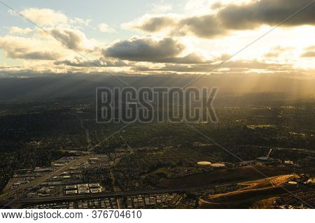 Aerial View Of Sunlight From Behind Cloud On The Land