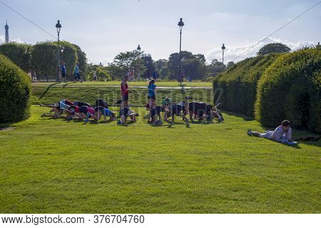 Paris, France - July 04, 2018: Young People Play Sports On The Grass In The Tuileries Gardens In Par