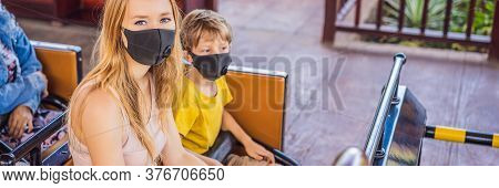 Mom And Son On A Roller Coaster In Medical Masks After The Coronovirus Epidemic Covid 19 Banner, Lon