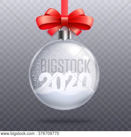 Glass Bauble With Number 2020 And Snow Inside It Decorated With Red Ribbon