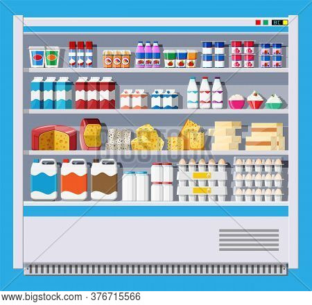 Showcase Fridge For Cooling Dairy Products. Different Colored Bottles And Boxes In Fridge. Refrigera