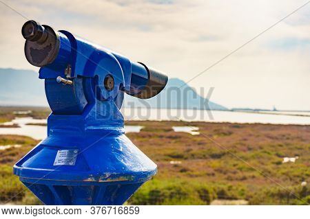 Tourism Vacation And Travel. Sightseeing Binoculars Tourist Telescope, Overlooking Las Salinas Lands