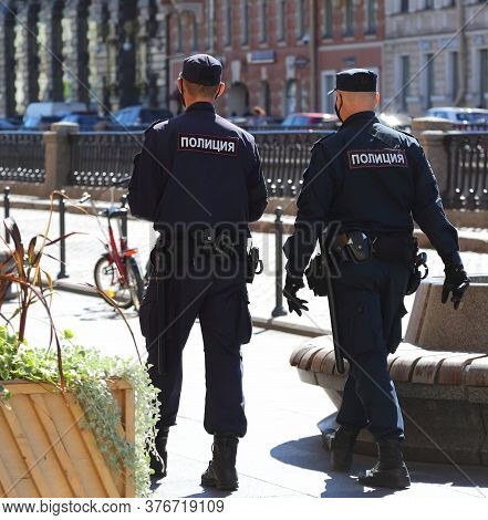 Two Russian Police Officers On Patrol, Griboyedov Canal Embankment, Saint Petersburg, Russia July 20
