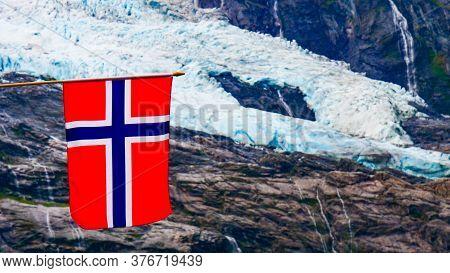 Norwegian Flag And Boyabreen Glacier In Fjaerland Area In Sogndal Municipality In Sogn Og Fjordane C