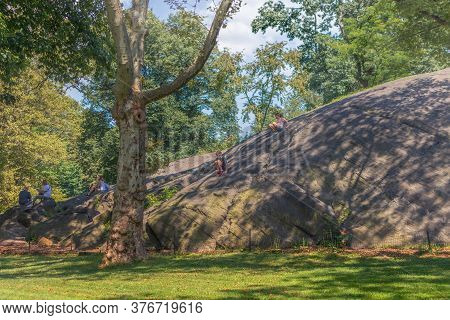 New York, Ny / Usa - July 24, 2019: Children Playing On Umpire Rock. Rat Rock, Also Known As Umpire