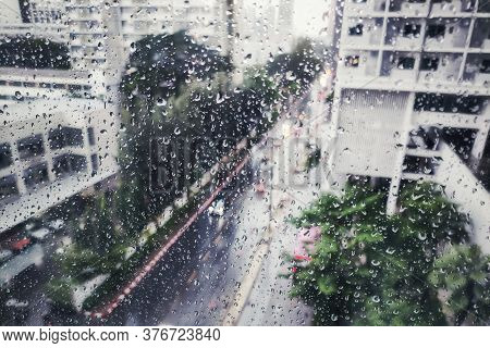 Raining On The Street, Aerial View. Water Drop Caught On Glass Apartment Window.  Looking Down On Ro