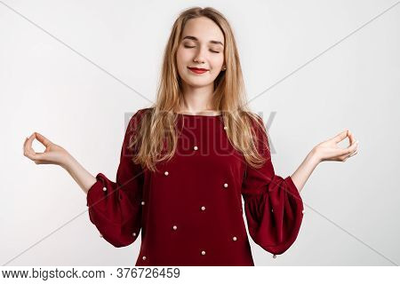 Attractive Calm European Girl With Long Blonde Hair Delighted Meditating Hands Sideways Nirvana Lotu