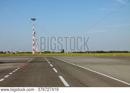 Lighting Masts By A Take-off Runway Of An Airport. Airspace Industry Concept
