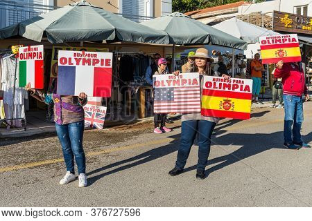 Katakolo, Greece - November 11, 2019: The Local People Invite Cruise Ship Passengers To Excursions T