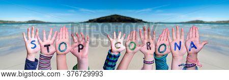 Children Hands Building Word Stop Corona, Ocean Background