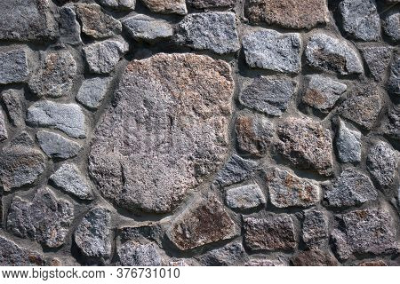 Stone Wall, Texture. Granite Stones Of Different Sizes, Masonry. Background