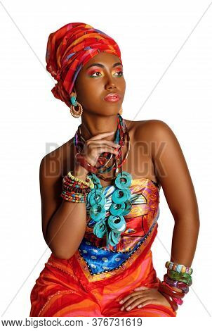 Portrait Of A Young And Attractive African American Black Woman In The National African Dress. Cosme