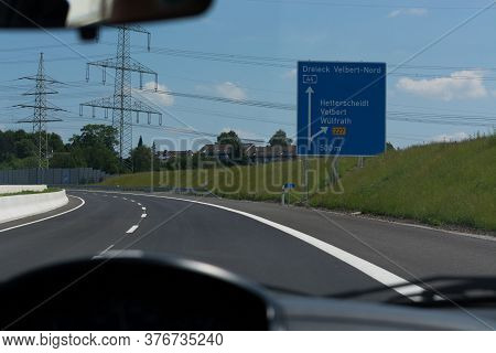 German Motorway Sign With Inscription In German Driving Direction To The Cities - Velbert, Heiligenh