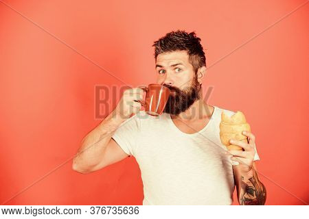 Bearded Hipster Enjoy Breakfast Drink Coffee. Morning Tradition Concept. Aroma Of Fresh Baked Croiss