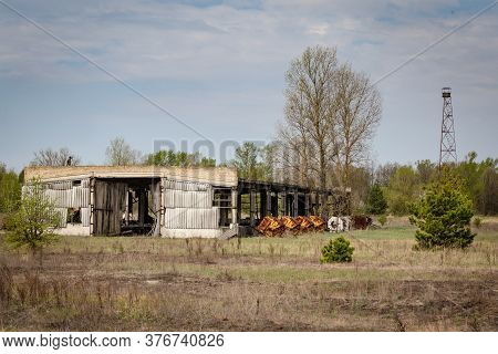 Collapsed Farm Stable And Watchtower In Belarus Chernobyl Exclusion Zone,