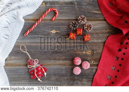 New Year Flat Lay: Christmas Cones And Gifts, Linen Tree With Hearts, Candy Cane, Tiny Snow Apples,