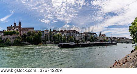 Basel, Bl / Switzerland - 8 July 2020:  Large River Barge Transporting Goods On The Rhine Near Basel