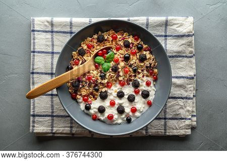 Healthy Breakfast. Bowl With Oat Granola, Yogurt And Black Raspberries, Black And Red Currants On A