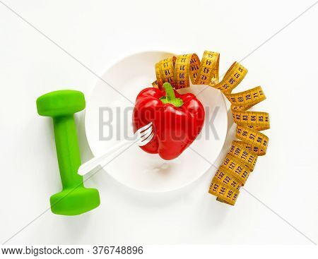 Collage Of Dumbbell, Sweet Pepper And Centimeter. Collage Located On A White Background. Fitness And