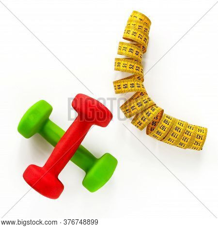 Collage. Colored Dumbbells And A Centimeter Are Located On A White Background. Fitness Helps You Los