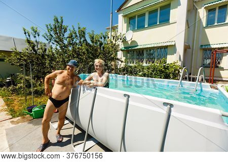 Close Up Of Pensioner Man In The Pool Swimming, Active People And Healthy And Fit Senior, Lifestyle