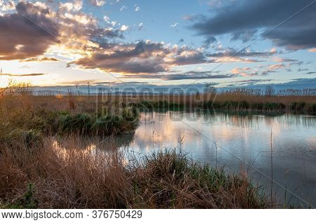 Sunset At The Albufera De Valencia In Autumn. Wild Vegetation And Reflections. Protected Natural Are