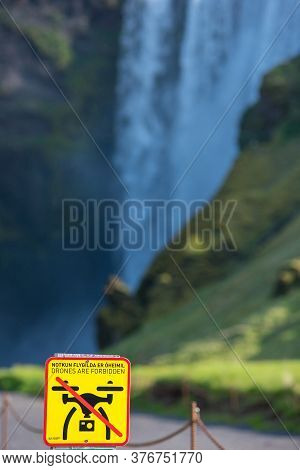 Skogafoss, Iceland - May 24, 2019: Drones Are Forbidden, No Fly Zone Sign Warning The Tourists To No