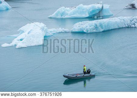 Guard Patrolling In A Boat At Jokulsarlon, Iceland